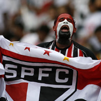 A fan of Sao Paulo soccer team cheers before the Brazilian soccer league final match against Goias in Brasilia, Sunday, Dec. 7, 2008.  (AP Photo/Eraldo Peres)