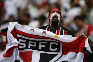 A fan of Sao Paulo soccer team cheers before the Brazilian soccer league final match against Goias in Brasilia, Sunday, Dec. 7, 2008.  (AP Photo/Eraldo Peres)